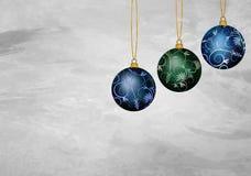 Tres ornamentos de la Navidad Fotos de archivo