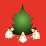 Tres ovejas alrededor del árbol del Año Nuevo Fotografía de archivo