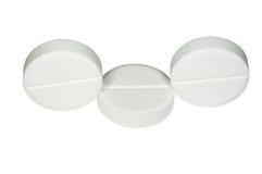 Tres píldoras blancas Fotografía de archivo libre de regalías