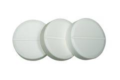 Tres píldoras blancas Fotografía de archivo