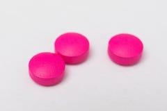 Tres píldoras redondas de la rosa Foto de archivo