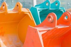 Tres palas coloreadas del excavador Foto de archivo libre de regalías