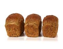 Tres panes de pan con ocho cereales Fotos de archivo libres de regalías