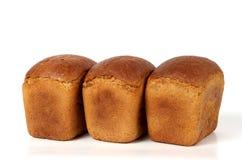 Tres panes de pan de centeno Fotos de archivo