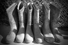 Tres pares de botas de goma del trabajo Imagen de archivo libre de regalías