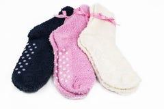 Tres pares de calcetines coloridos Foto de archivo