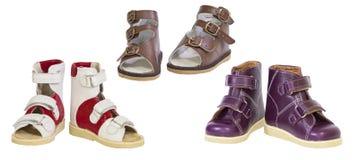 Tres pares de los zapatos ortopédicos de los niños Fotos de archivo libres de regalías