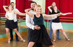 Tres pares felices que bailan tango Fotografía de archivo libre de regalías
