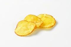 Tres patatas fritas fotografía de archivo libre de regalías