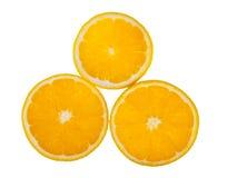 Tres pedazos de las naranjas Foto de archivo