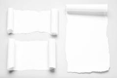 Tres pedazos de papel con las esquinas encrespadas Fotos de archivo libres de regalías