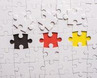 Tres pedazos de rompecabezas. Imagen del concepto del edificio del trabajo en equipo Fotografía de archivo