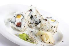 Tres pedazos de sushi aislados en blanco Imagen de archivo libre de regalías
