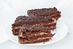 Tres pedazos de torta de chocolate Fotografía de archivo libre de regalías