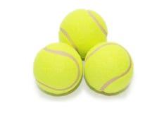 Tres pelotas de tenis aisladas Imagen de archivo libre de regalías