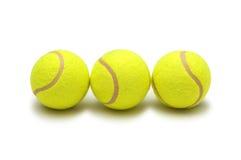 Tres pelotas de tenis aisladas Imágenes de archivo libres de regalías