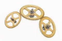 Tres pequeñas ruedas dentadas viejas Fotografía de archivo libre de regalías