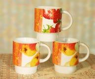 Tres pequeñas tazas Imagen de archivo