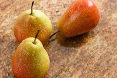 Tres peras maduras de Forelle Imagenes de archivo