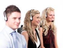 Tres personas en un centro de llamada Imagen de archivo