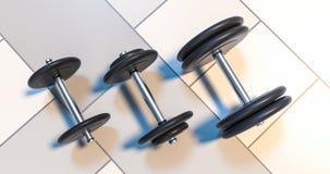 Tres pesas de gimnasia que se colocan en el ejemplo de la fila 3d Fotos de archivo libres de regalías