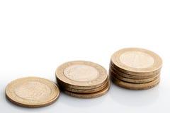 Tres pilas aisladas de monedas viejas Imágenes de archivo libres de regalías