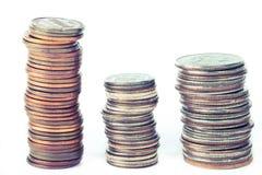 Tres pilas de monedas Imagen de archivo