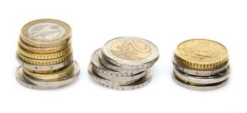 Tres pilas de monedas Foto de archivo