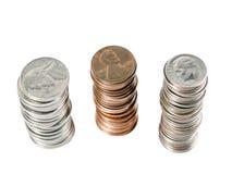 Tres pilas de nosotros monedas de arriba Fotografía de archivo
