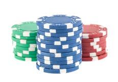 Tres pilas de virutas de póker Foto de archivo libre de regalías