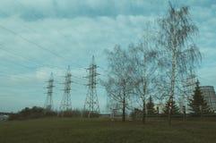 Tres pilones y tres árboles Foto de archivo