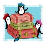 Tres pingüinos con las maletas listas para el viaje Imagenes de archivo