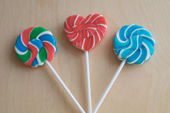 Tres piruletas coloridas del azúcar Fotografía de archivo