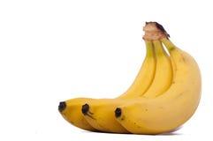 Tres plátanos aislados en el fondo blanco Fotos de archivo libres de regalías