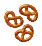 Tres pretzeles aislados en el fondo blanco imagenes de archivo