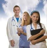 Tres profesionales médicos Imágenes de archivo libres de regalías
