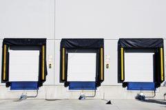 Tres puertas de la carga foto de archivo