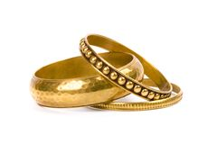 Tres pulseras de oro Imagen de archivo libre de regalías