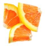 Tres rebanadas anaranjadas, aisladas en blanco Fotos de archivo libres de regalías