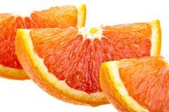 Tres rebanadas anaranjadas aisladas en blanco Imágenes de archivo libres de regalías