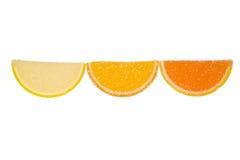 Tres rebanadas de mermelada en un fondo blanco Foto de archivo