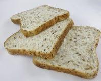 Tres rebanadas de pan integral. Imágenes de archivo libres de regalías