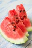 Tres rebanadas frescas de melón rojo Imágenes de archivo libres de regalías