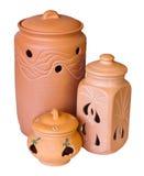 Tres recipientes de la arcilla aislados en un fondo blanco Imagen de archivo libre de regalías