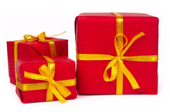 Tres rectángulos de regalo rojos Fotos de archivo