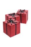 Tres rectángulos de regalo rojos Imagenes de archivo