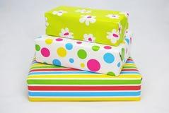 Tres regalos con el papel coloreado Foto de archivo libre de regalías