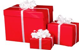 Tres regalos de Navidad con los arcos de la cinta aislados Fotografía de archivo