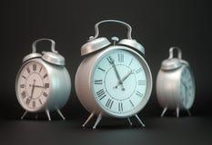 Tres relojes de alarma Fotografía de archivo libre de regalías