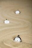 Tres relojes de bolsillo viejos, formato vertical Imagen de archivo